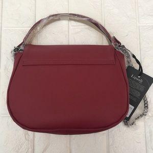 60a35ee45b94 Lipault Plume Elegance Ruby Leather Saddle Bag NWT